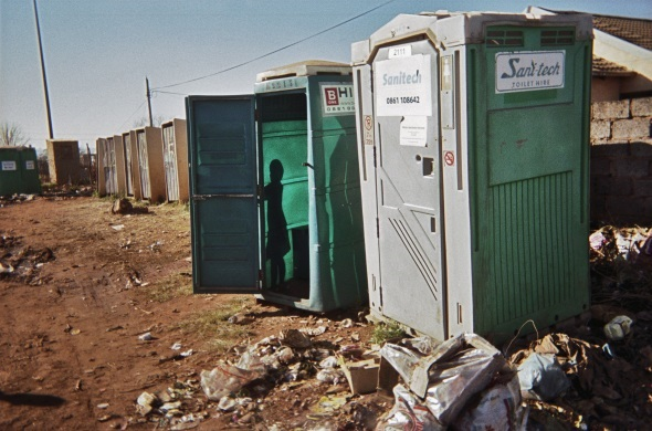 Shared toilet facilities in an informal settlement in Cape Town. Photo: SERI
